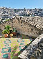 Geometric tiles on Mediterranean roof terrace with view of city