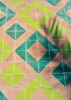 Geometric tiles in shades of blue and green