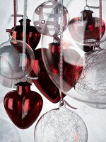 Red glass love-hearts and transparent Christmas baubles