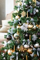 Christmas tree decorated with ornamental fish and metallic baubles
