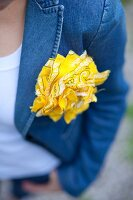 Yellow rosette made from bandana on denim jacket
