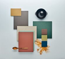 A colourful selection of kitchen cabinet panels and a cast-iron mortar