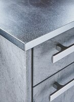 A stainless steel kitchen worktop (detail)