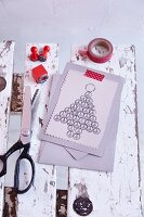 Hand-made Christmas card with stamped Christmas tree motif made from the peace symbol