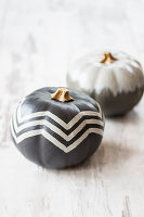 Pumpkins painted grey with white pattern and grey ombré