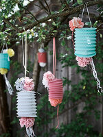 Lanterns in a garden decorated with paper flowers