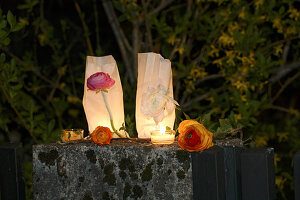 Romantic candle lanterns made from sandwich bags, tealights and flowers