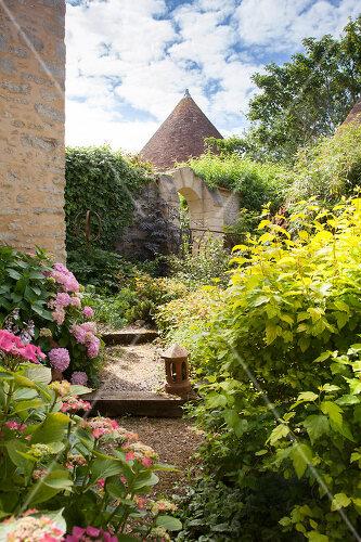 Romantic garden in Moulins-sur-Orne, France