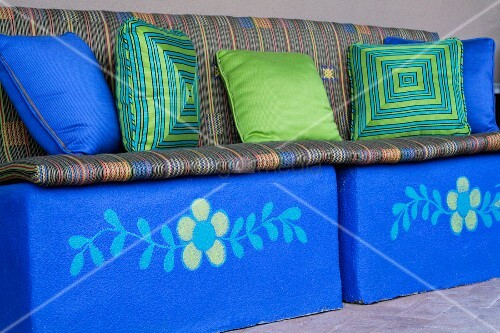 Bright blue bench with decorative throw pillows and cushions ? Bild kaufen ? living4media