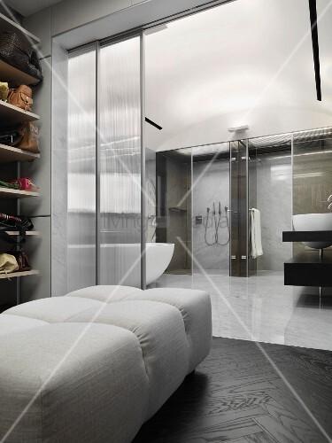 gepolsterte bank in ankleide mit offener glast r und blick in zeitgen ssisches bad bild kaufen. Black Bedroom Furniture Sets. Home Design Ideas