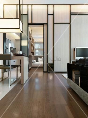 moderner arbeitstisch mit art deko h ngelampe vor gestalteter holztrennwand im wohnzimmer bild. Black Bedroom Furniture Sets. Home Design Ideas