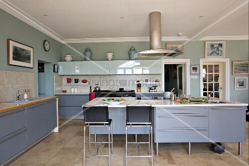 Large Modern Kitchen With Blue Grey Cupboard Doors And Bar Stools At Free Standing Kitchen