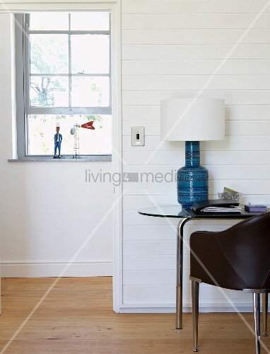 Chair in front of table lamp with white lampshade on side for Chair next to window