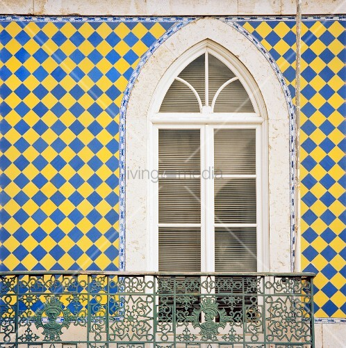 House facade with window balcony colourful wall tiles for Balcony wall tiles