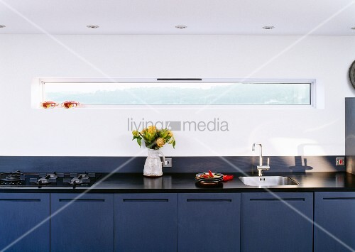 Long designer kitchen counter with blue base units for Long kitchen wall units