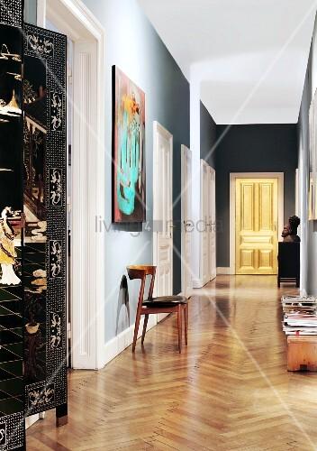 golden illuminated door at end of long hallway in