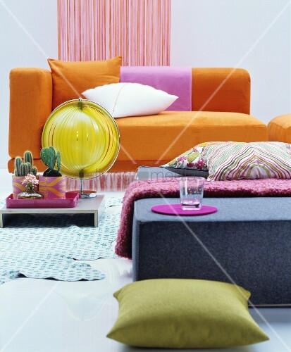 Orange chaise longue and felt ottoman in retro interior for Chaise longue orange