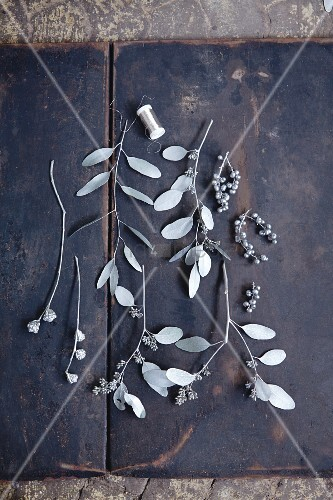 Twigs and leaves sprayed with silver paint