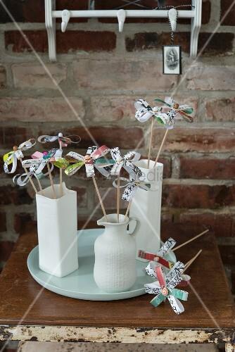 Homemade paper flowers in vases