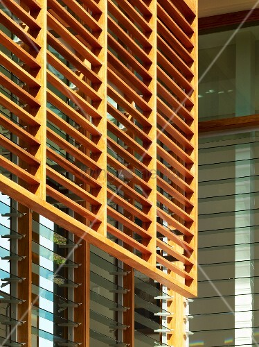 Glass Louver Facade : Wooden louvers in front of a house facade with adjustable