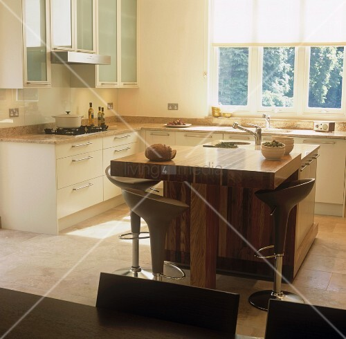 An open plan kitchen with a free standing wooden for Free standing bar plans