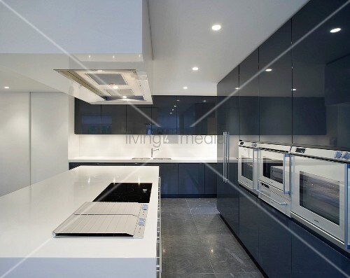 cool designer kitchen with white kitchen units in front of b