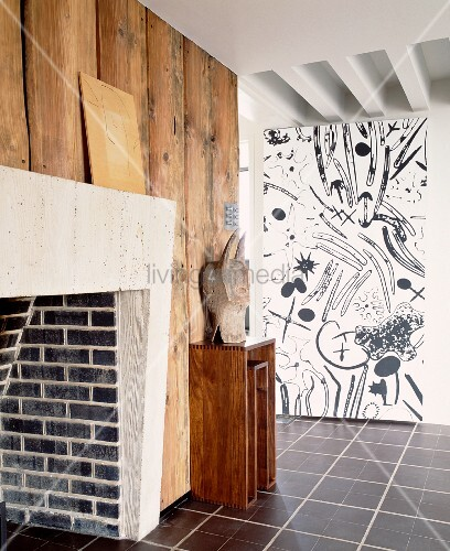 Wood Cladding On Brick Wall : Brick fireplace on wood clad wall opposite with black