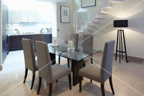 Dining table with chairs and standard lamp under stairs in for Dining room under stairs