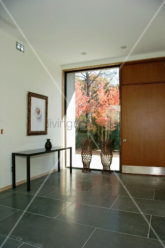 Foyer Window Price : Modern foyer with large grey tiles and floor to ceiling