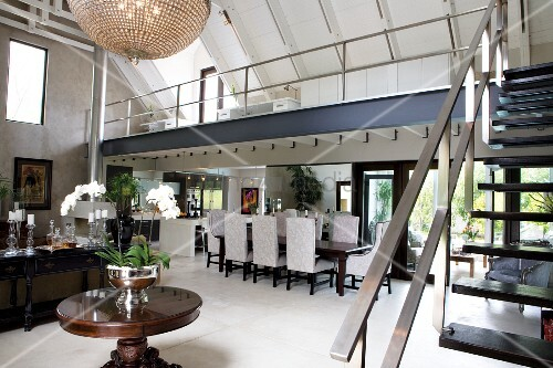 Classically elegant dining area and antique furniture in country house loft with open plan - Open mezzanine ...