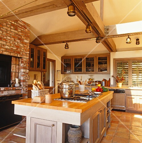 Kitchen Island In Open-plan Kitchen Of Rustic Country