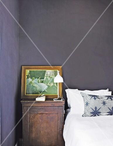 picture on old bedside cabinet in bedroom with black walls. Black Bedroom Furniture Sets. Home Design Ideas