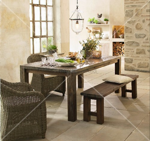Rustic dining area in country house kitchen with stone for Rustic dining area