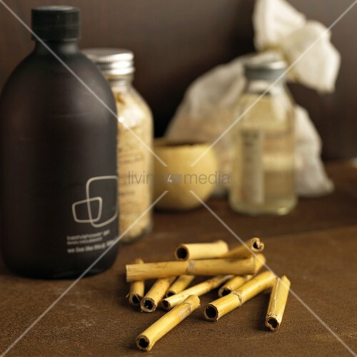 bamboo stems and bottles of toiletries bild kaufen. Black Bedroom Furniture Sets. Home Design Ideas