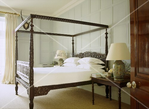 A traditional bedroom with painted panelling carved for Traditional four poster beds