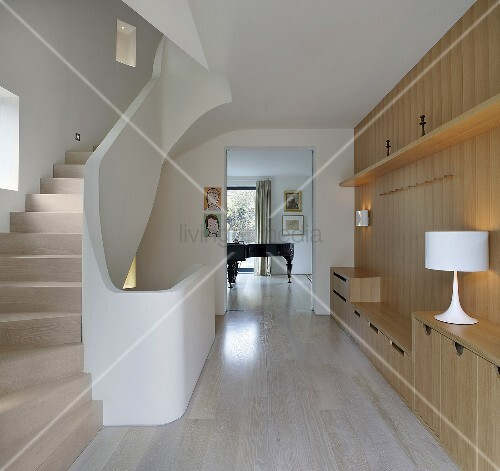 Modern staircase with wood paneled walls and custom made