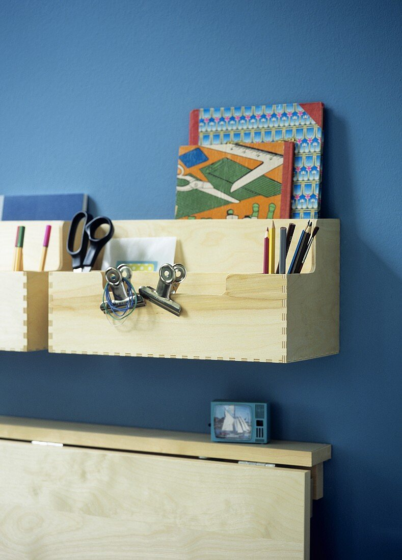 Fold-down desk with wooden storage boxes