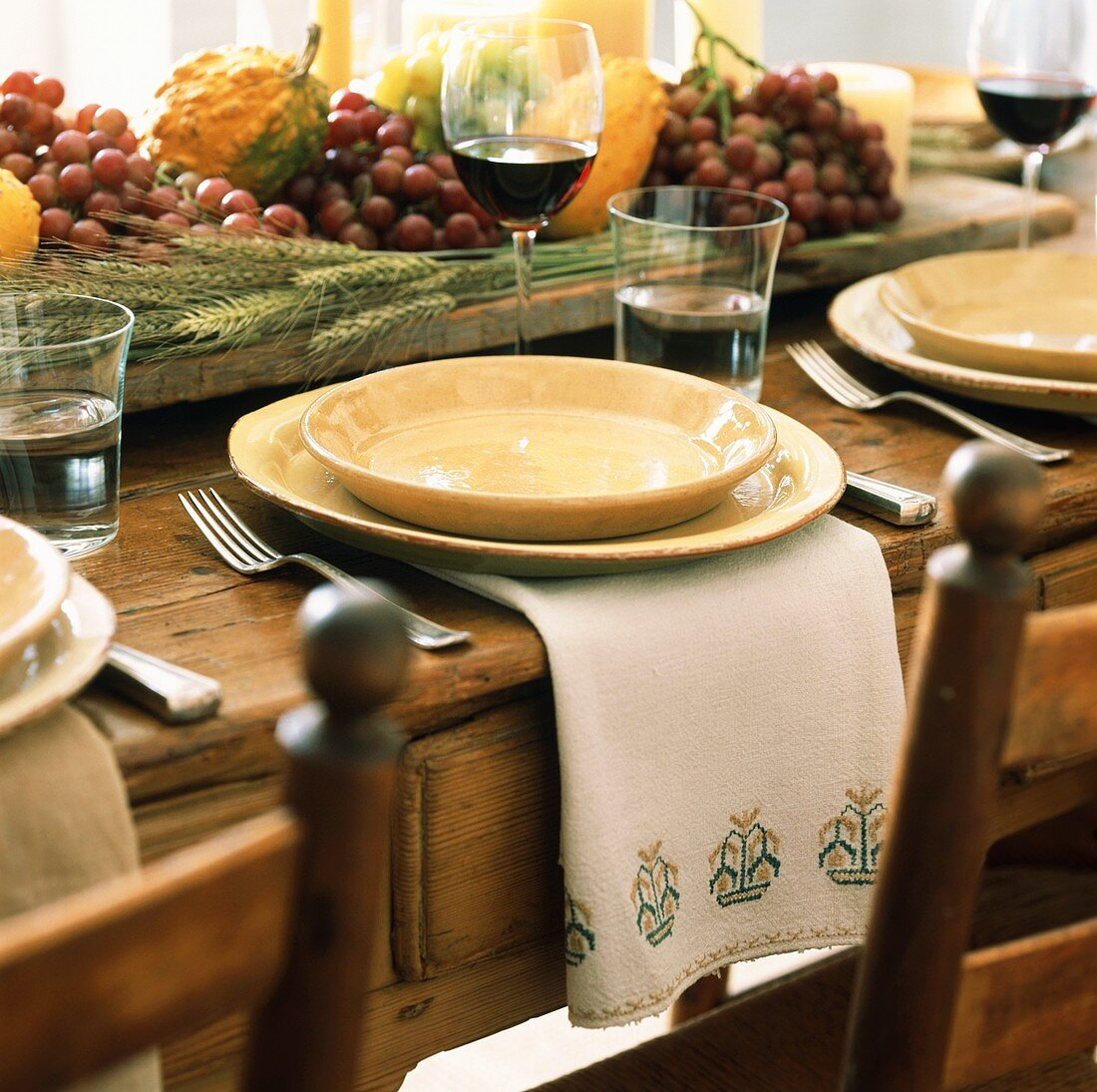 Place-setting on table laid for Thanksgiving
