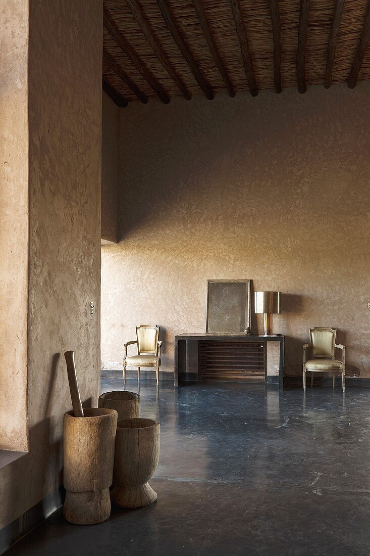 A minimalistic anteroom with wooden tubs in a Mediterranean country house