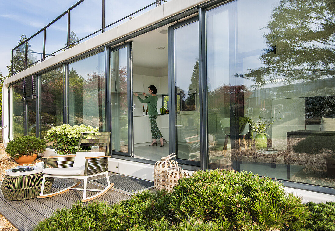 woman in a modern kitchen, coodo modern way of living, modern architecture in Hamburg, north Germany, Germany