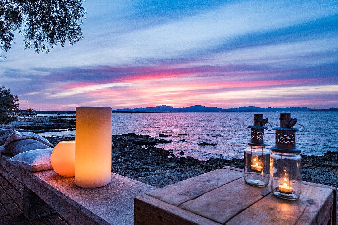 sunset over Alcudia bay, promenade at Colonia de Sant Pere, Mallorca, Balearic Islands, Spain