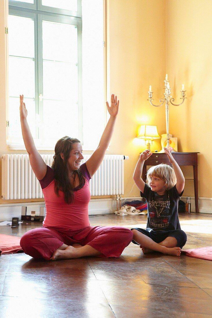 A yoga teacher and a child in a studio