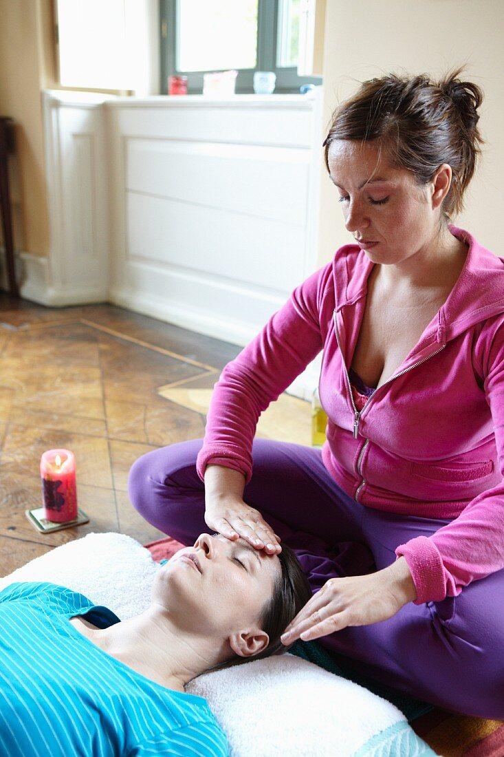 A woman having an oil face massage