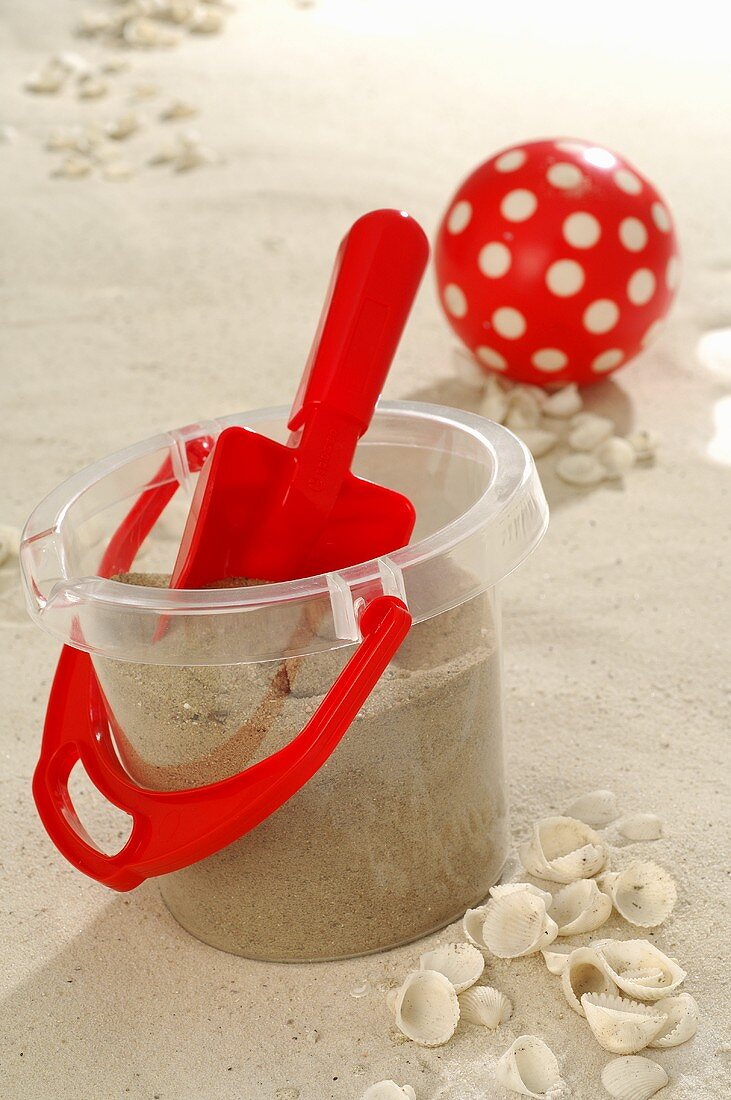 Bucket and spade in sand