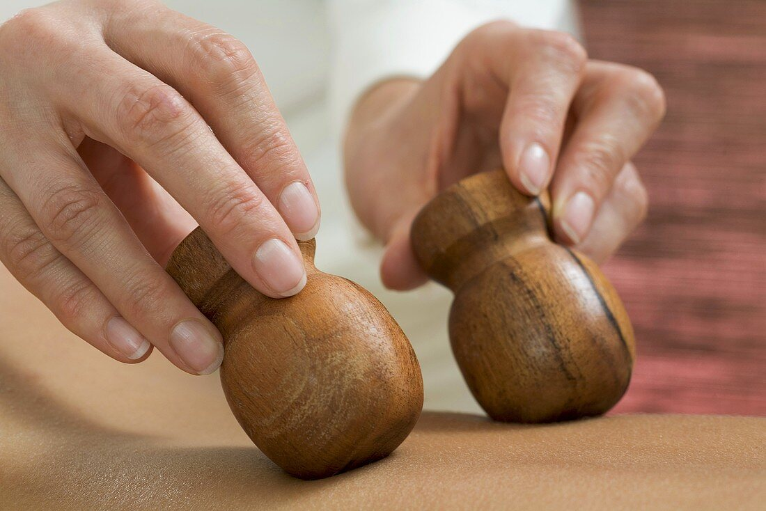 Massaging with wooden massagers