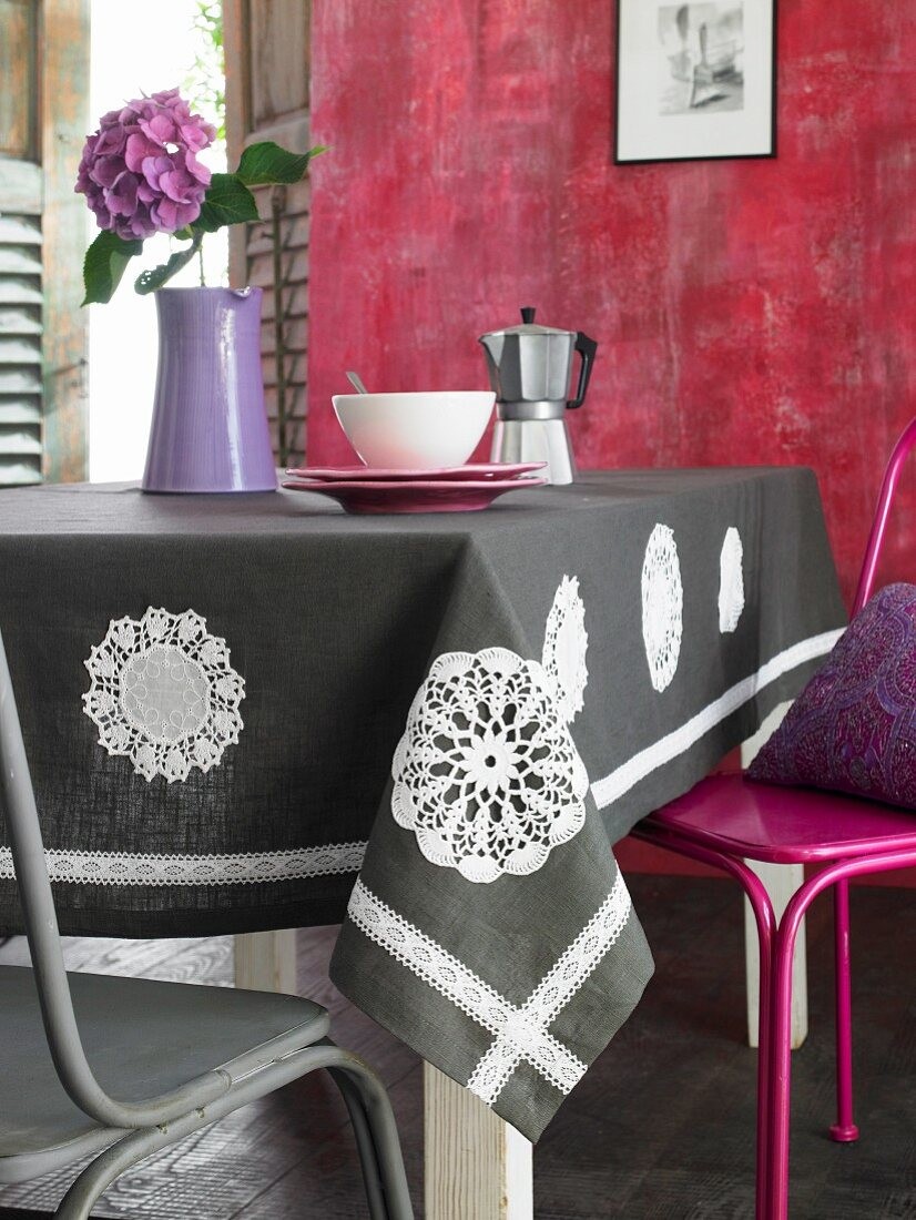 Table cloth decorated with appliqué, crocheted doilies