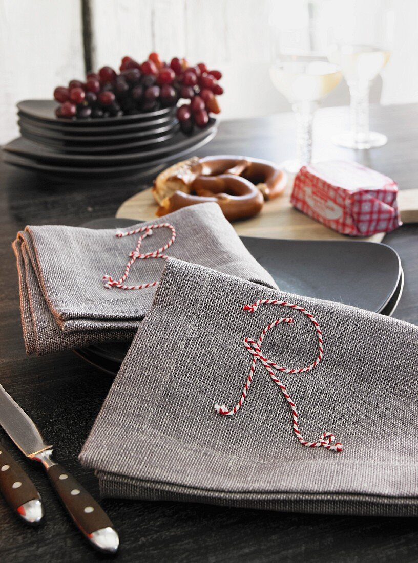 Linen napkins embroidered with twine letters