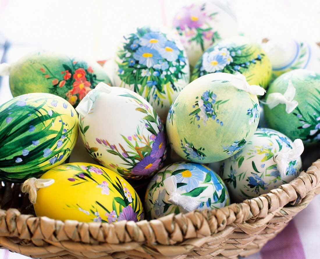 Floral pattern painted duck eggs in a basket
