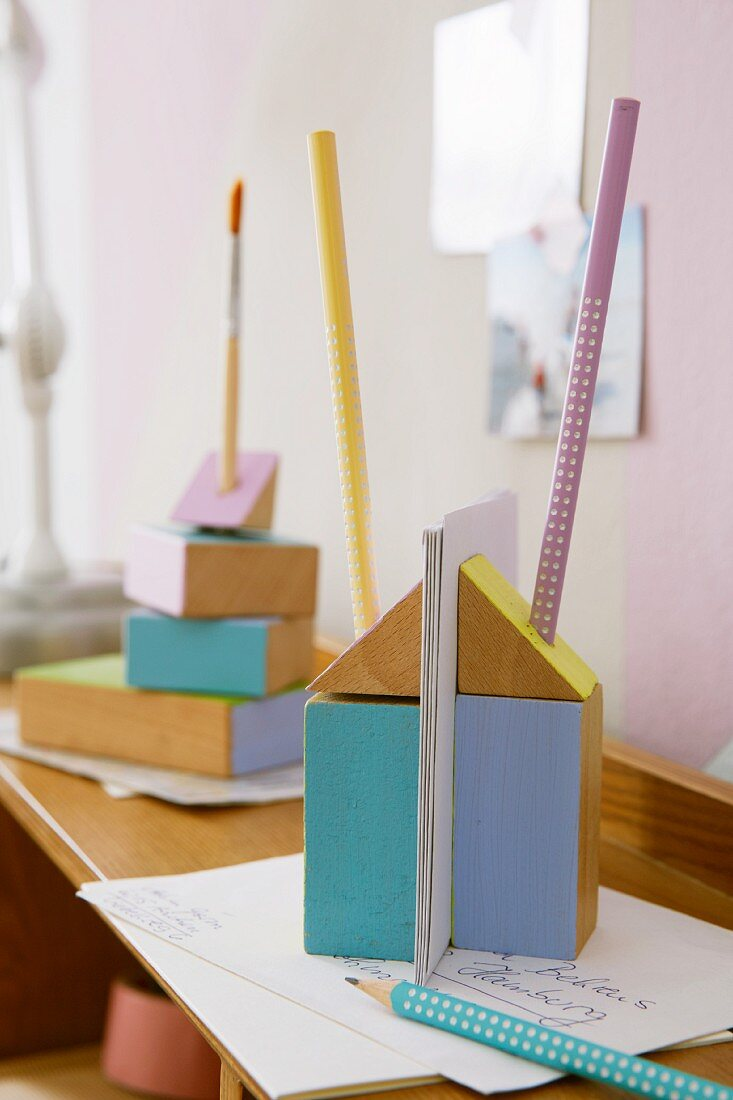 Pastel-painted building blocks as letter and pen holders