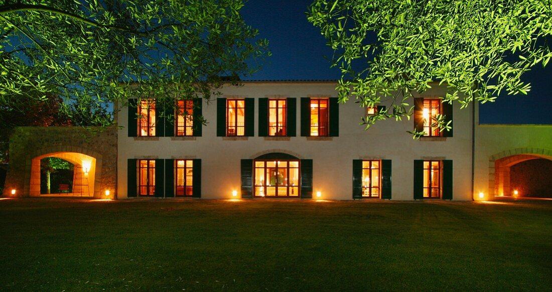 Rear exterior Spanish villa at dusk